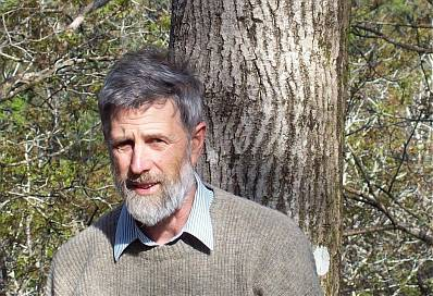 Photo of Nick Nelson Parker in front of healthy walnut tree trunk